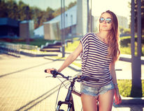 Trendy Hipster Girl with Bike in the City Stock Photos