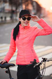 Trendy Hipster Girl with Bike on Urban Background. Toned and Filtered Photo. Modern Youth Lifestyle Concept. girl in a Royalty Free Stock Images