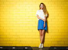 Trendy Hipster Girl at the Brick Wall Royalty Free Stock Image