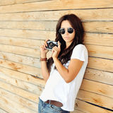 Trendy hipster girl with camera Royalty Free Stock Photos