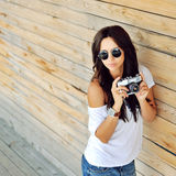 Trendy hipster girl with camera Royalty Free Stock Images