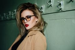 Trendy Hipster Girl in glasses on vintage dressing room background. stock photos
