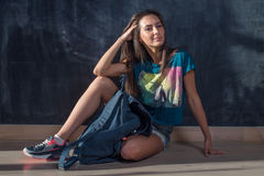 Trendy Hipster Girl in jeans shorts and t-shirt Stock Images