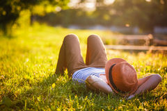 Trendy Hipster Girl Relaxing. On the Grass Stock Photography
