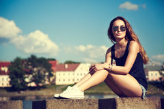 Trendy Hipster Girl Relaxing in the Park Stock Image