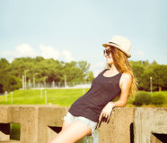 Trendy Hipster Girl Relaxing in the Park Royalty Free Stock Images
