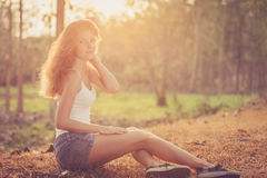 Trendy Hipster Girl  Relaxing on the road at the day time. Royalty Free Stock Images