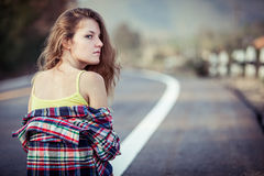 Trendy Hipster Girl  Relaxing on the road at the day time. Royalty Free Stock Photo