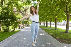 Trendy Hipster Girl Walking in the Park. Modern Youth Lifestyle Concept royalty free stock photography