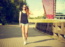 Trendy Hipster Girl Walking in the Park Stock Image
