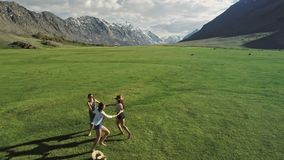 Trendy Hipster Girls having fun outdoor. Three cute women are whirling on green grass. Best friends. stock footage