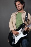 Trendy hispanic guitarist Stock Image
