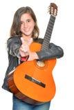 Trendy hispanic teenage girl carrying a guitar Royalty Free Stock Photography