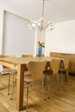 Trendy interior. New and trendy dining room with modern furniture Stock Image