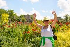 Trendy joyful Grandma outdoors in her garden Royalty Free Stock Images