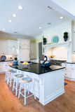 Trendy kitchen. Trendy expensive kitchen with white and oak Royalty Free Stock Photography