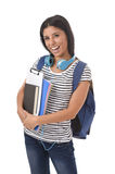 Trendy latin student girl holding notepad folder and book carrying backpack smiling happy Stock Photography