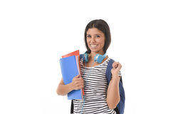 Trendy latin student girl holding notepad folder and book carrying backpack smiling happy Stock Photos