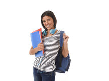 Trendy latin student girl holding notepad folder and book carrying backpack smiling happy Royalty Free Stock Photography