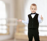 Trendy little boy in a black suit with a tie. Royalty Free Stock Image