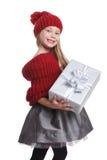 Trendy little girl holding a present Stock Photos