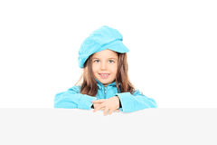 Trendy little girl posing behind blank panel Stock Photos