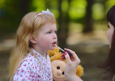 Trendy little girl in the summer park. Cute Little redhead girl in the summer park Stock Photography