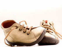 Trendy little golden baby shoes  with copyspace Stock Image