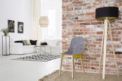 Trendy loft with brick wall. And white living room royalty free stock photos
