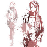 Trendy look girl with color splashes Stock Photos