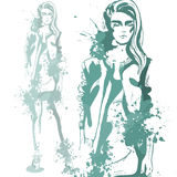 Trendy look girl with color splashes Royalty Free Stock Images
