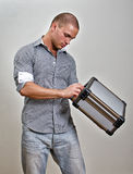 Trendy male holding suitcase. Royalty Free Stock Images