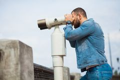 Trendy male person look in binocular telescope Royalty Free Stock Photos