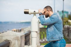 Trendy male person look in binocular telescope Royalty Free Stock Image
