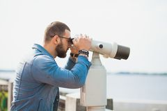 Trendy male person look in binocular telescope Royalty Free Stock Photo