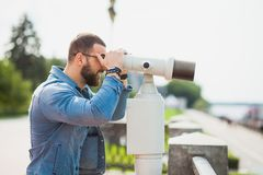 Trendy male person look in binocular telescope Stock Photography