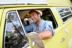 Trendy man driving a camper van Royalty Free Stock Photos