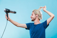 Trendy man with hair dryer Stock Image