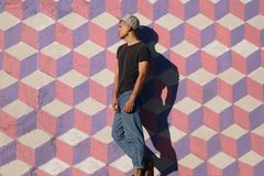Trendy man on painted wall Royalty Free Stock Image