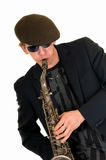 Trendy man playing saxophone Stock Photography