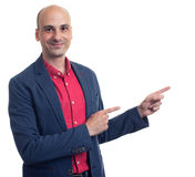 Trendy man pointing finger. Isolated Stock Image