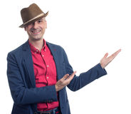 Trendy man presenting something over white background Royalty Free Stock Photos
