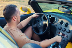 Trendy man steering Stock Photography