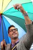 Trendy man under umbrella Stock Photography