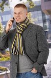 Trendy man using mobile phone Royalty Free Stock Photo