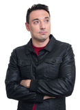 Trendy man wearing leather jacket and looking up Stock Images