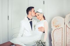 Loving groom holding woman on hands stock photo