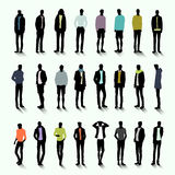 Trendy men with long shadow. Set of trendy male silhouettes with colour elements of clothing Stock Image