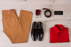 Trendy men's set. Trendy men's set of clothes and accessories on a wooden background Royalty Free Stock Image