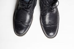 Trendy men`s shoes.fashion still life. men black boots stock photos